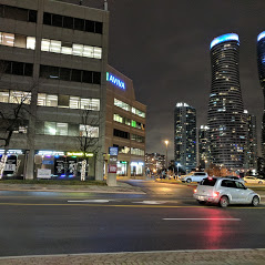 Techknow Space and Absolute Condos - a busy Roadside view
